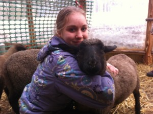 Kiah and her lamb, Patience.