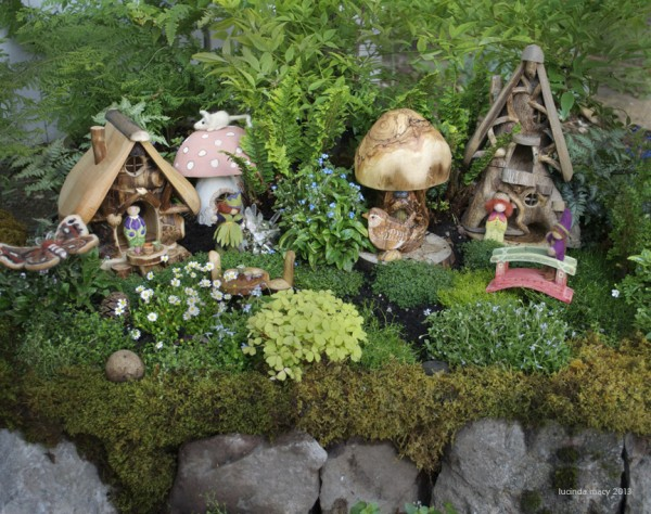 The Fairy Garden is our Summer project. It was started in a large rectangular cement mixing tub, so it can theoretically be moved in winter. Adding details  such as a creek and a pond and many small things will be endless fun!
