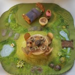 "I am a great believer in the ""play mat"". I think it creates a  special space and place for the stirring of the imagination and ones own creative ideas. It also is an opportunity to work with wool and felt, which I love just as much as wood."